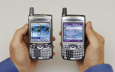 Holding Treo 700W and Treo 650